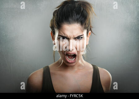 Scream of angry upset young woman - Stock Photo