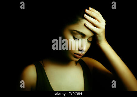 Depression Concept. Sad Young Woman with Face in the Dark - Stock Photo
