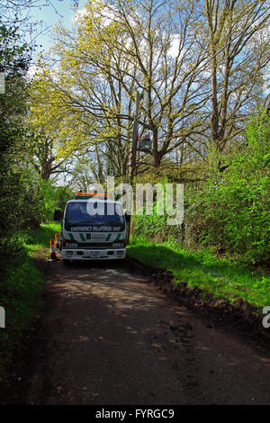 An lorry mounted emergency power generator sat in the middle of a country lane and hooked up to a transformer on - Stock Photo