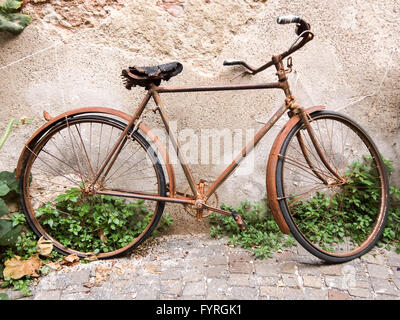 Old rusty vintage bicycle - Stock Photo