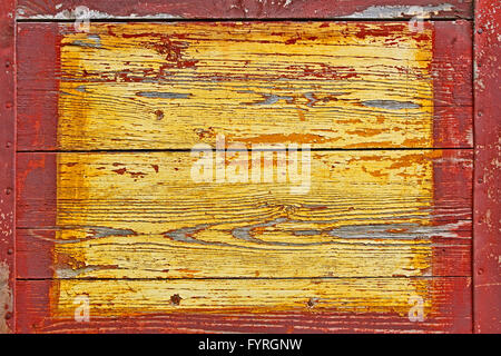 Old wooden shield with metal borders - Stock Photo