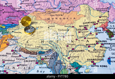 Asia map and compass - Stock Photo