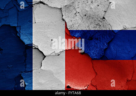 flags of France and Russia painted on cracked wall - Stock Photo