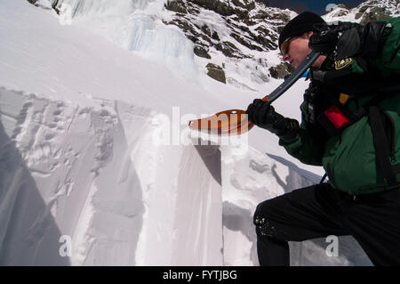 Avalanche forecaster preparing a compression test in the slopes of Tuckerman Ravine, NH - Stock Photo