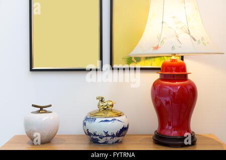lamp on table agaist white wall - Stock Photo