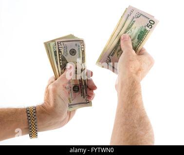Caucasian ethnicity hands holding fan of US dollar bills - Stock Photo