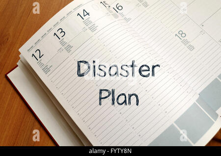 Disaster plan write on notebook - Stock Photo