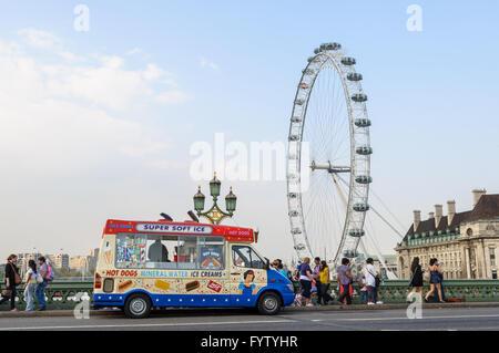 Ice cream van on Westminster Bridge, the London Eye in the background in London, UK - Stock Photo