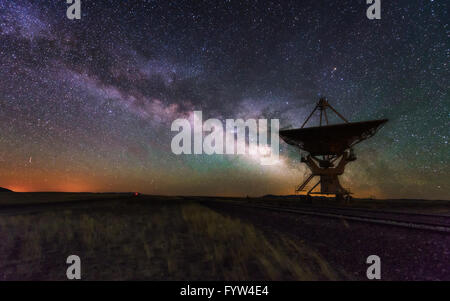 Milky way and big antenna dish at Very Large Array, New Mexico, USA. Powerful telescope for astronomy searching - Stock Photo
