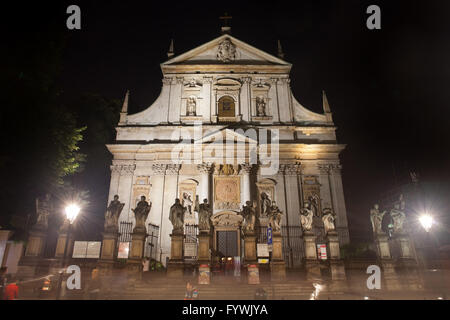 Church of Saints Peter and Paul at night in the Old Town of Krakow in Poland, city landmark, Baroque architecture - Stock Photo