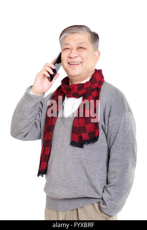 portrait old smiling Asian man standing confidently - Stock Photo