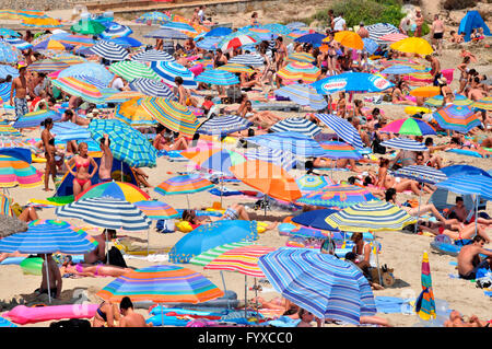 Beach Son Moll, Cala Rajada, Mallorca, Spain / Cala Ratjada, sunshades - Stock Photo