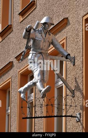 Jumping soldier, by Conrad Schumann, Berlin wall memorial site, Brunnenstrasse, Bernauer Strasse, Mitte, Berlin, Germany / Mauergedenkstätte, Berliner Mauer, barbwire