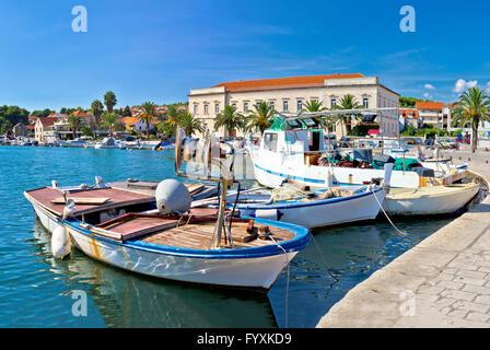 Fishing boat in Stari Grad harbor - Stock Photo