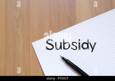 Subsidy write on notebook - Stock Photo