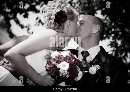 Happy bride and groom after wedding - Stock Photo