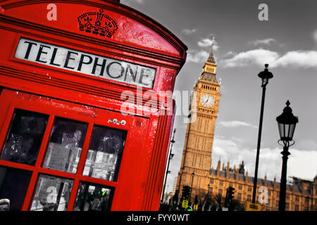 Red telephone booth and Big Ben in London - Stock Photo