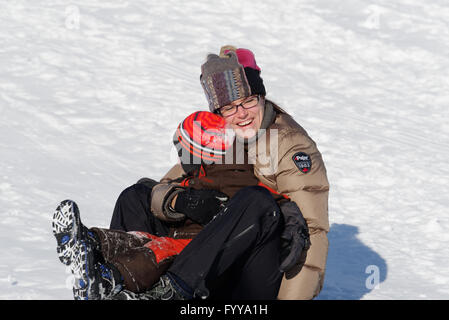 Mother and Son (4 years old)  sledging in Quebec Canada - Stock Photo