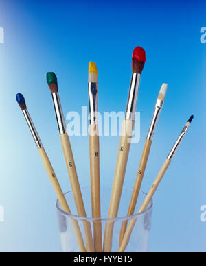 Paint brushes in a cup, indoors. - Stock Photo