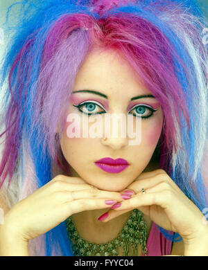 Punk girl with multi-coloured pastel hair, inside. - Stock Photo