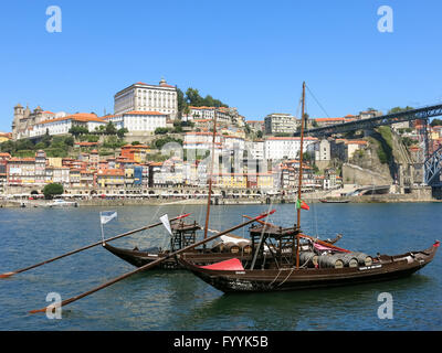 Traditional rabelo boats on Douro River and Ribeira District, Porto, Portugal - Stock Photo