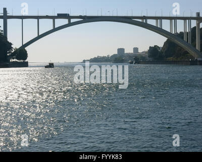 Ponte da Arrabida, last bridge over Douro River towards Atlantic Ocean, Porto, Portugal - Stock Photo
