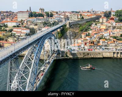 View of Dom Luis I Bridge, city walls and Muralha Fernandina from Mosteiro da Serra do Pilar in Gaia, Porto, Portugal - Stock Photo