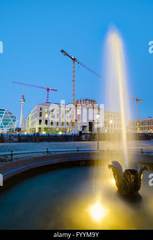 Fountain in front of building site Berlin Palace - Stock Photo