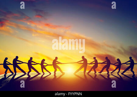 Two groups of people pulling line - Stock Photo