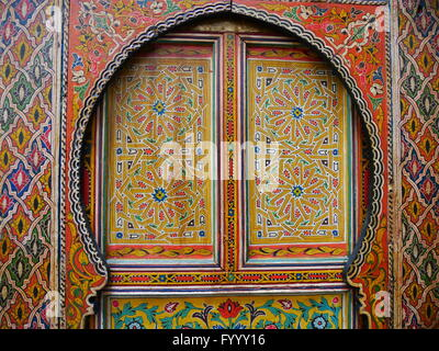 Traditional, intricately patterned, colourfully painted door in Fez, Morocco.The patterns are floral in red, yellow, - Stock Photo