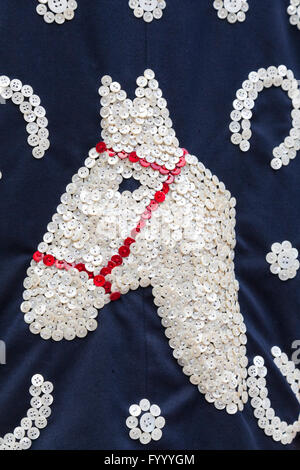 Hundreds of mother-of-pear buttons are sewn into a horse and horse shoe detail motif on the suit of John Scott, - Stock Photo
