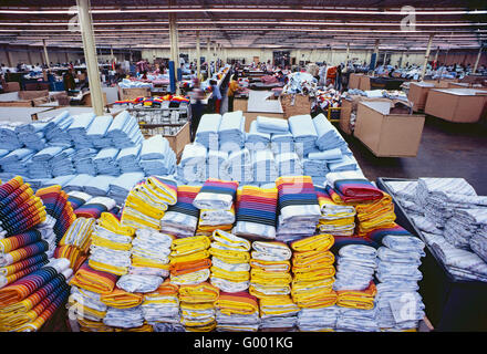 Stacks of colorful finished cotton sheets in a garment manufacturing facility - Stock Photo