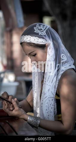 Beautiful Asian woman wearing a white veil. Thailand S. E. Asia. Asian beauty