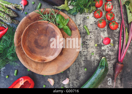Healthy harvest of fresh vegetables. Still life with various vegetables and plate. Top view, vintage toned image, - Stock Photo