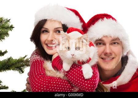 Young happy couple near a Christmas tree. - Stock Photo