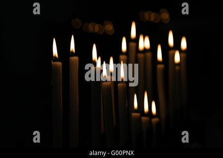 White Candle flames with black background - Stock Photo