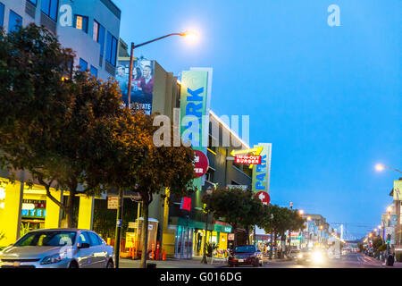 A Row of Shops with an IN-N-Out Hamburger store on Beach Street near Fisherman's Wharf in San Francisco California - Stock Photo