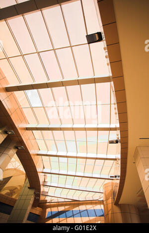 yellow unusual geometric ceiling of office building - Stock Photo