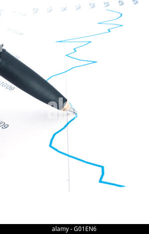 pen on graph (focus on the tip of the pen) - Stock Photo
