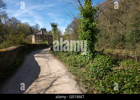Old cottage beside the river Goyt near Marple, Stockport. A sunny spring day. - Stock Photo