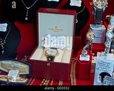 PATEK PHILLIPE High value used watches including Patek Philippe jewelery and gems on sale in luxury shop window - Stock Photo