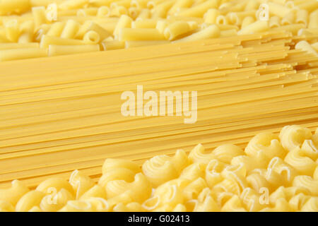 A lot of pasta. Background made from spaghetti and penne - Stock Photo