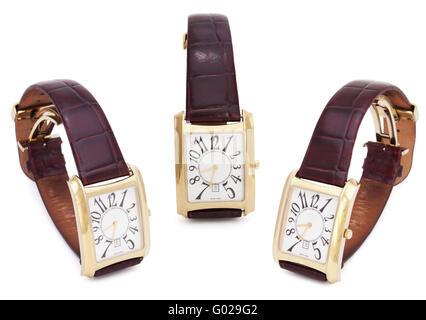 Three Golden Wristwatches isolated on the white background - Stock Photo