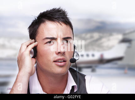 young smiling men operator with headphones portrait - Stock Photo