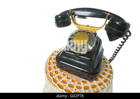 Old antique vintage traditional black phone with disc dials the 19th century isolated on white background  with - Stock Photo