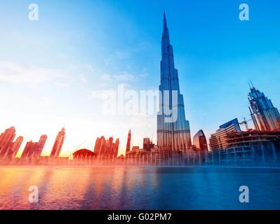 DUBAI, UAE - FEBRUARY 17: Burj Khalifa and fountain - world's tallest tower at 828m at beautiful sunset light - Stock Photo