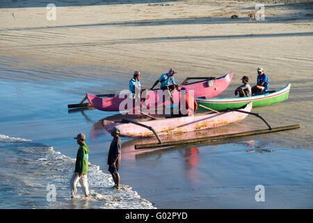 Fishing Boats on the beach in Jimbaran Bay, Bali. - Stock Photo