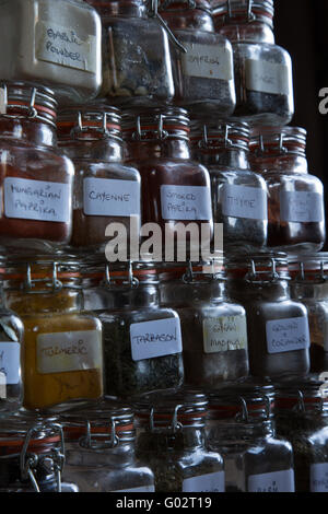 Abstract view of herbs and spices stacked in Kilner jars. - Stock Photo