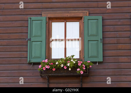 Austria Kitzbuhel Traditional Wood Clad House and Window - Stock Photo