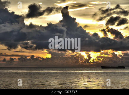 Ship with threatening clouds over South China Sea at Phu Quoc, Vietnam - Stock Photo